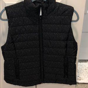 black loft vest with flowers